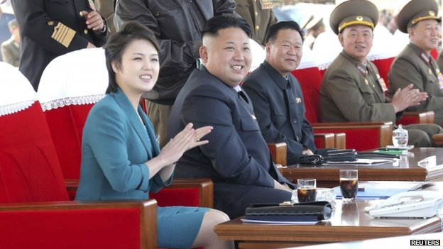 North Korean leader Kim Jong-un and his wife Ri Sol-ju attend the 2014 Combat Flight Contest among commanding officers of the Korean People's Air Force in this undated photo released by North Korea's Korean Central News Agency (KCNA) in Pyongyang on 10 May 2014.