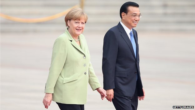 German Chancellor Angela Merkel is welcomed by Chinese Premier Li Keqiang