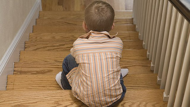 A child sitting on stairs