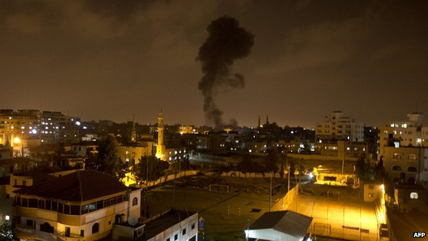Smoke rises after an Israeli missile strike hits the Gaza Strip. 7 July 2014