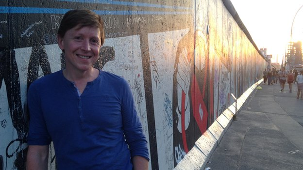 Damien Mcguinness by the Berlin wall