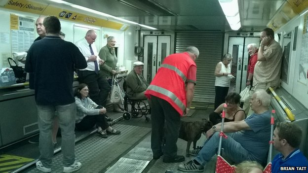 Passengers being taken without their cars in a train to France