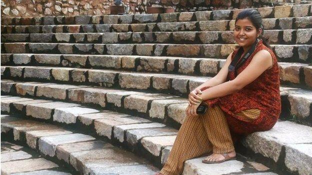 Akanksha Saxena sitting in ruins of old fort