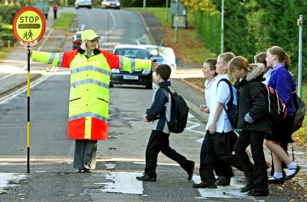 Generic lollipop lady at school crossing