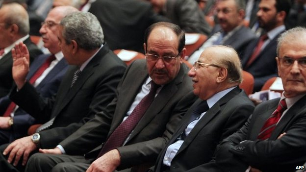 Iraqi Prime Minister Nuri al-Maliki (centre) at the first session of parliament on 1 July