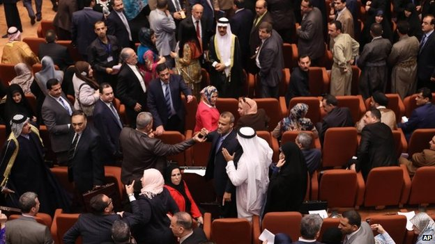 Iraqi MPs argue during the first session of the new parliament on 1 July