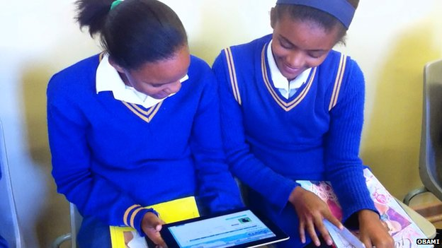 Girls looking at computer tablet