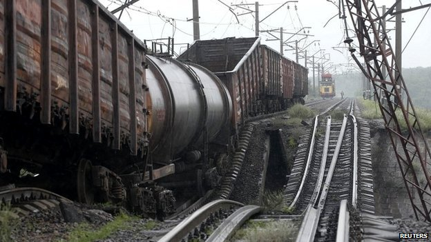 A train stands on a destroyed railroad bridge which fell over a main road leading to the eastern Ukrainian city of Donetsk, near the village of Novobakhmutivka - 7 July 2014