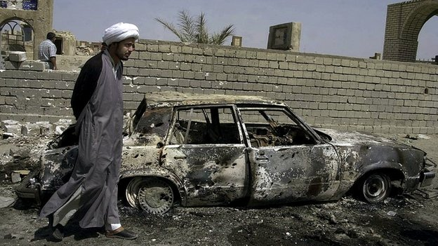 Qais al-Khazali inspects damage after clashes in Najaf, Iraq - 26 May 2004