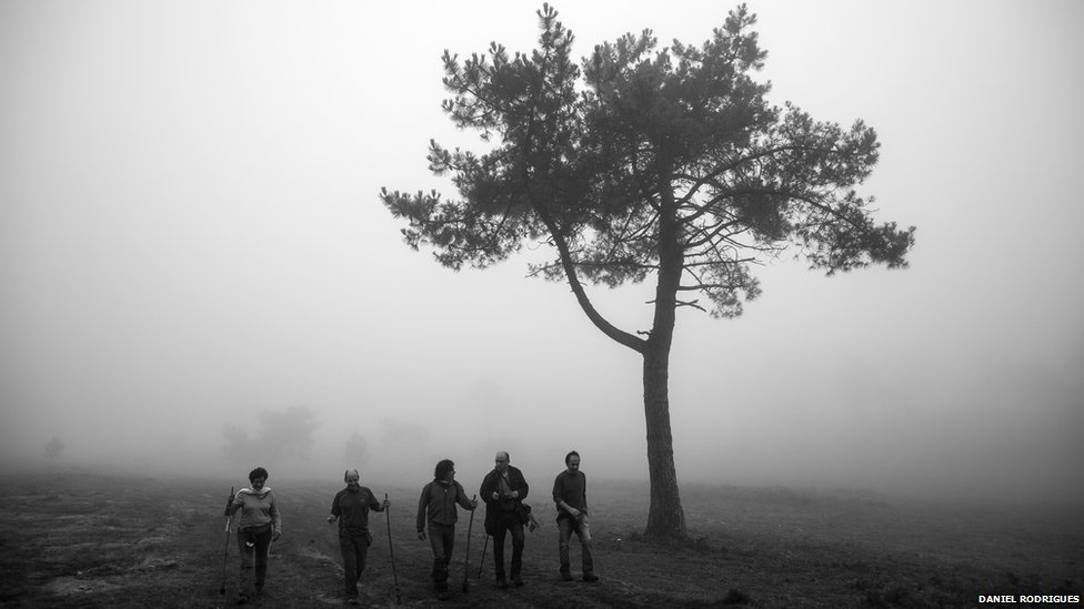Villagers head of into the hills of Galicia