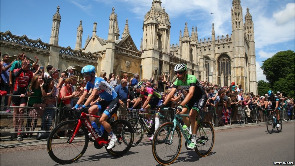 Riders passing Cambridge University