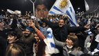 Uruguayans show their support for banned striker Luis Suarez