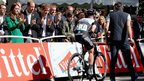 The Duke and Duchess of Cambridge and Prince Harry applaud as Cavendish rides over the finish line
