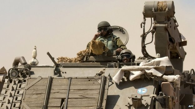 Israeli soldiers on an armoured personnel carrier near the Gaza border. Photo: 7 July 2014