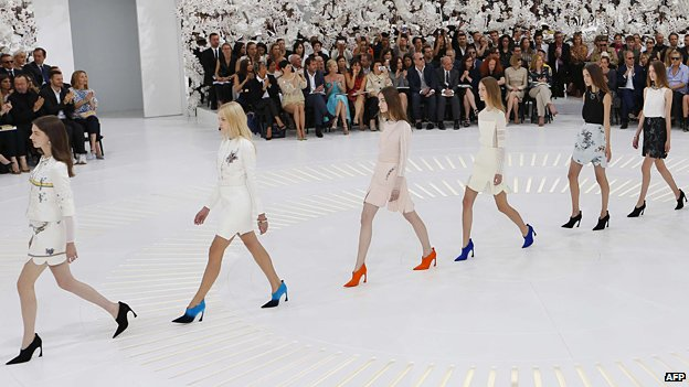 Models present creations for Christian Dior during the 2014/2015 Haute Couture Fall-Winter collection fashion show on 7 July, 2014