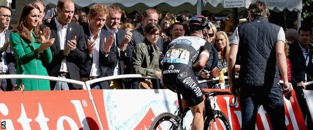 The Duke and Duchess of Cambridge and Prince Harry applaud Cavendish as he rides over the finish line