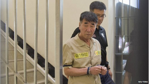 Lee Joon-seok, captain of sunken ferry Sewol, arrives at a court in Gwangju on 10 June 2014
