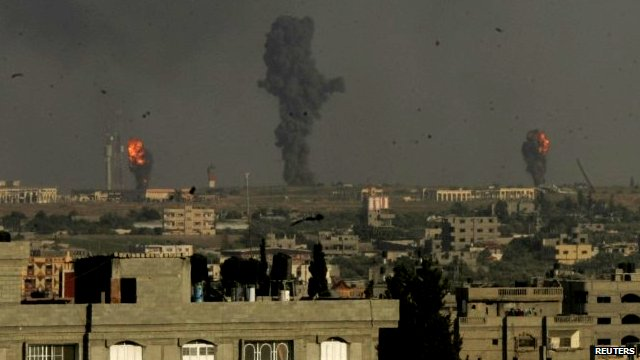 Smoke and flames are seen following what witnesses said were Israeli air strikes in Rafah in the southern Gaza Strip
