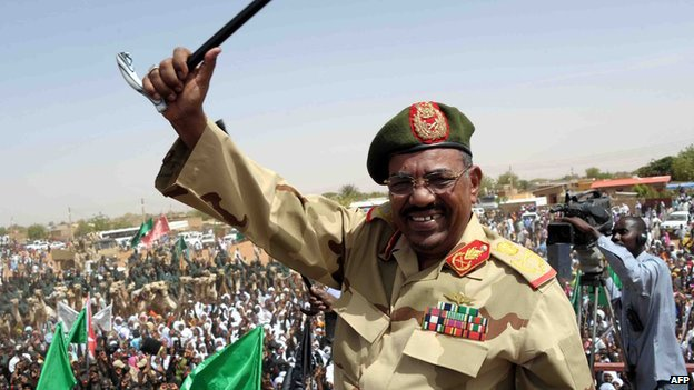 Sudanese President Omar al-Bashir waves to the crowd during his visit to the Northern Kordofan town of El-Obeid to address a rally of freshly-trained paramilitary troops on 19 April  2012