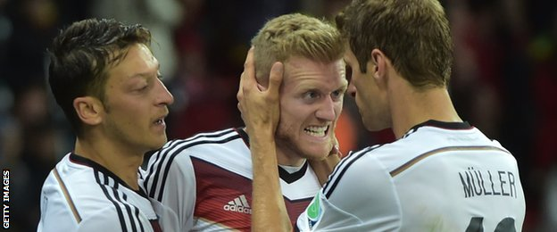 Mesut Ozil, Andre Schurrle and Thomas Muller celebrate a German goal at the 2014 Fifa World Cup