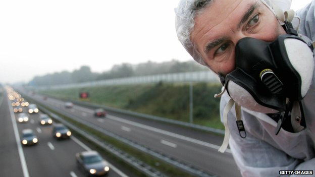 Anti-pollution protester at the A9 near Amsterdam