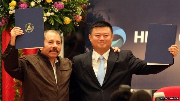 Nicaraguan President Daniel Ortega stands next to Wang Jing during the framework agreement for the construction of the Inter-oceanic Grand Canal in Managua on 14 June, 2013