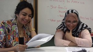 Two Iraqi refugees in a classroom in Virginia
