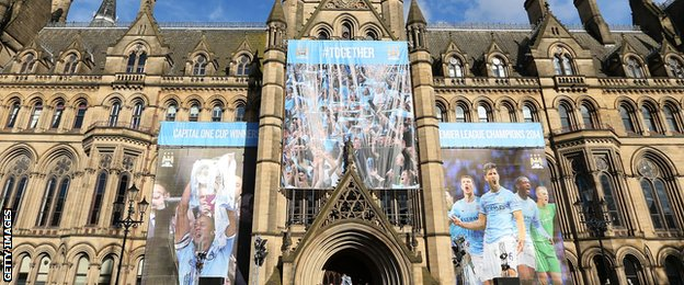 Manchester town hall is decked in City colours to celebrate the 2014 Premier League title win