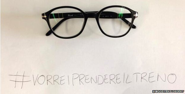 A tweet from @WoodyPhilosophy with a pair of glasses and the hashtag #VorreiPrendereilTreno