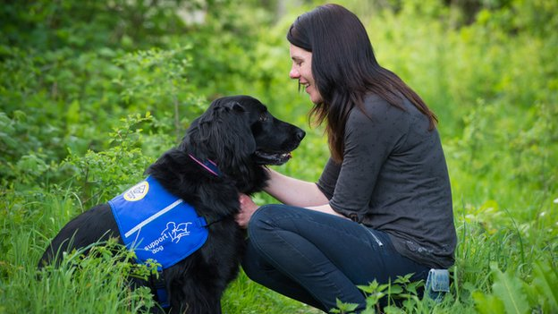 An owner with her seizure alert dog