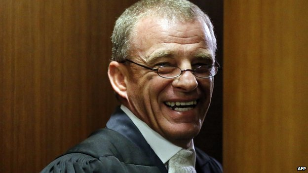 State prosecutor Gerrie Nel smiles at the end of trial proceedings on 8 July 2014 in Pretoria, South Africa