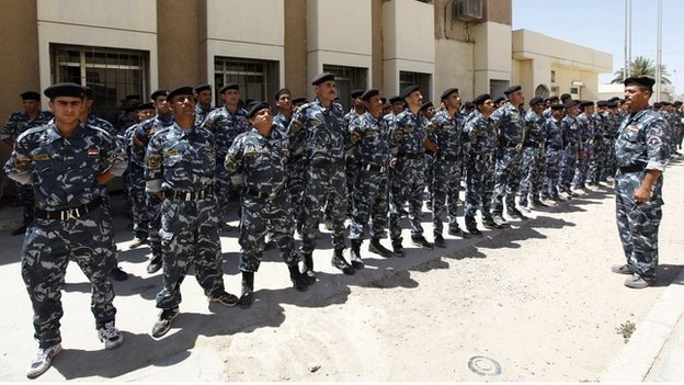 Volunteers, who have joined the Iraqi army to fight against Sunni militants, in Baghdad - 8 July 2014