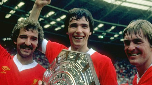 (Left to right) Graeme Souness, Alan Hansen and Kenny Dalglish of Liverpool hold the trophy after the Charity Shield