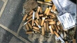 Cigarette butts discarded on street
