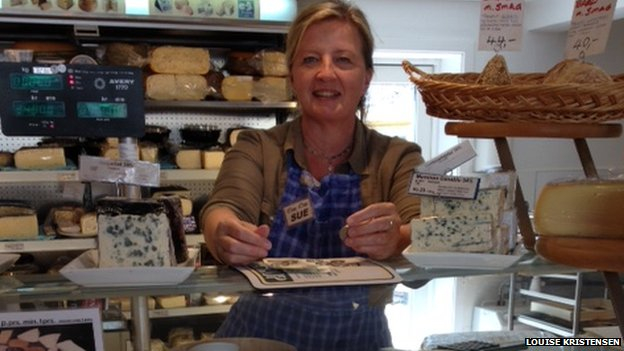 "Sue Jensen in her cheese shop, ""Øens Oste"""