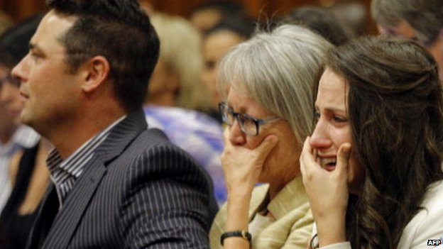 Aimee Pistorius (L), sister of South African Paralympic athlete Oscar Pistorius, cries as she hears her brother tell his story of the events on the night he killed Reeva Steenkamp at his murder trial in Pretoria, South Africa - 8 April 2014
