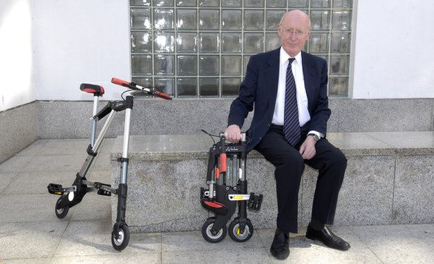 Sir Clive Sinclair with his collapsible bike