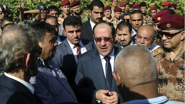 Iraqi Prime Minister Nouri Maliki attends the funeral ceremony a senior army commander in Baghdad - 7 July 2014