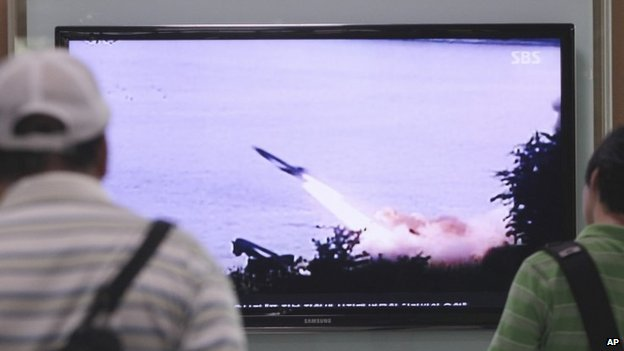People in South Korea watch on TV a missile launch in North Korea. Photo: 29 June 2014
