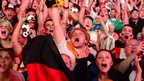 Germany fans cheer during a public viewing at the Brandenburg Gate in Berlin on July 8, 2014.