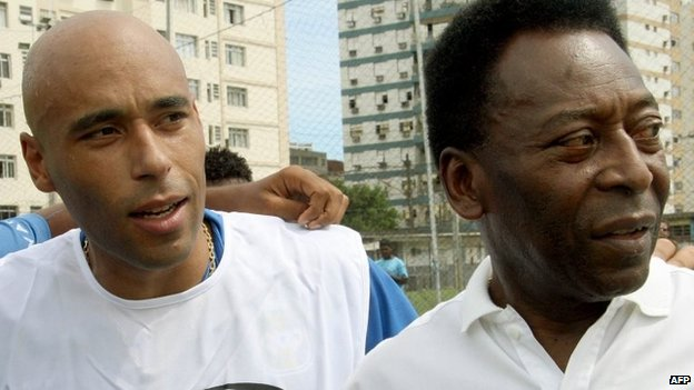Picture taken on 12 April, 2007 of Brazilian football star Pele (right) and his son, former footballer and coach of goalkeepers in Santos FC, Edson Cholbi Nascimento, aka Edinho