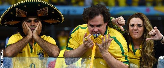 Dejected Brazil fans