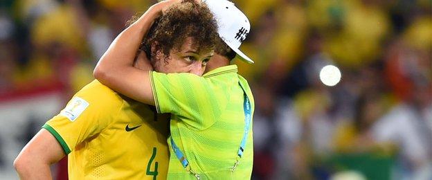 Suspended captain Thiago Silva consoles David Luiz