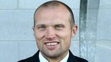 Linfield manager Warren Feeney in the dug-out at Mourneview Park