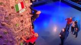 image of Matt Dawson on a rock climbing wall in a studio