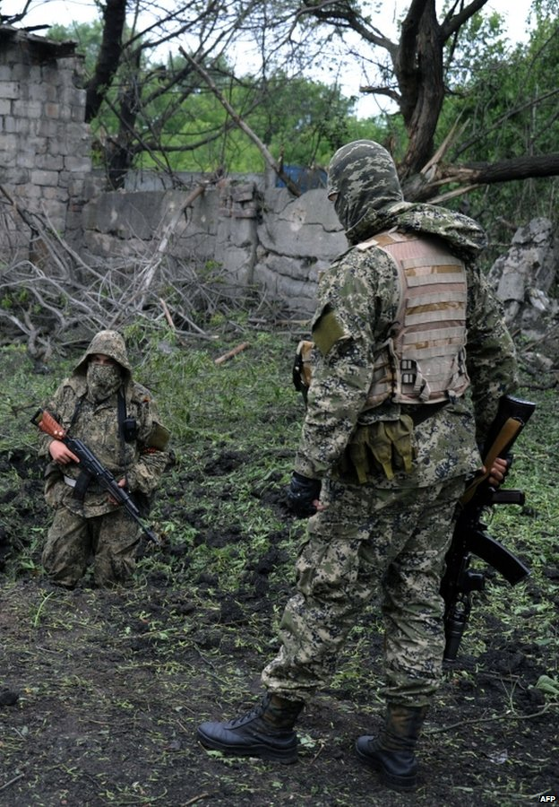 Rebel fighters in Donetsk region, 8 July