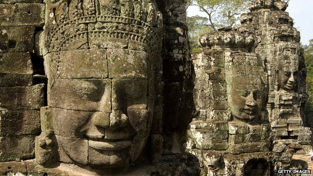 Stone faces on the Bayon Temple in the ancient Khmer capital of Angkor