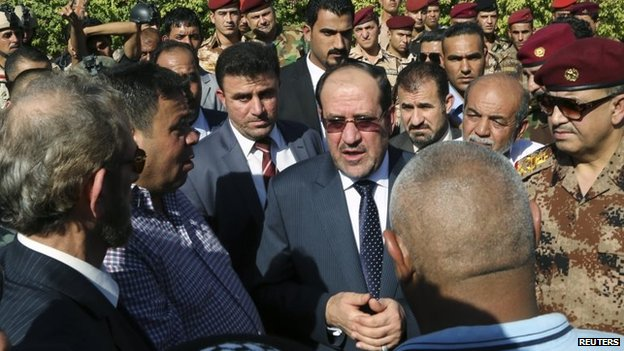 Iraqi Prime Minister Nouri Maliki attends the funeral of a general killed in recent fighting (7 July 2014)