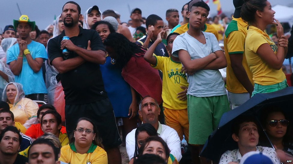 Brazil fans watch the first half on Copacabana Beach during the 2014 FIFA World Cup semi-final match between Brazil and Germany on 8 July 2014 in Rio de Janeiro, Brazil.