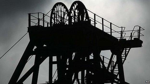 Silhouette of coal mine pit head